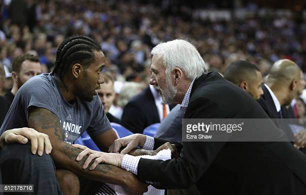 Head coach Gregg Popovich of the San Antonio Spurs talks to Kawhi Leonard of the San Antonio Spurs during their game against the Sacramento Kings at...
