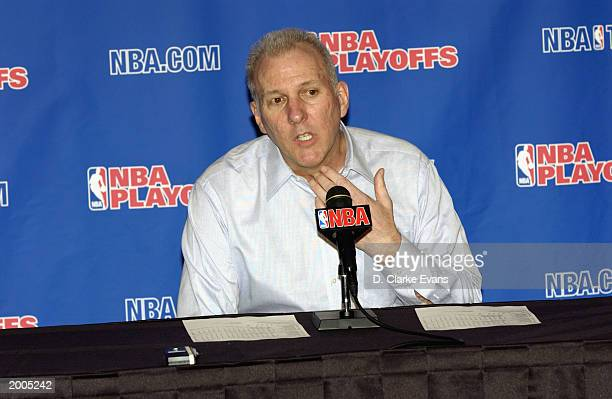 Head coach Gregg Popovich of the San Antonio Spurs talks to the media at the post game press conference following the victory over of the Los Angeles...