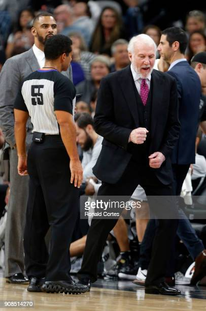 Head coach Gregg Popovich of the San Antonio Spurs talks with official Bill Kennedy during game against the Indiana Pacers at ATT Center on January...