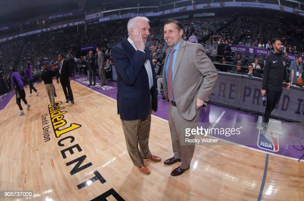 Head Coach Gregg Popovich of the San Antonio Spurs talks with Head coach Dave Joerger of the Sacramento Kings prior to the game on January 8 2018 at...