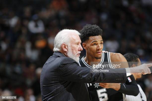 Head Coach Gregg Popovich of the San Antonio Spurs talks with Dejounte Murray of the San Antonio Spurs during the game against the Houston Rockets on...