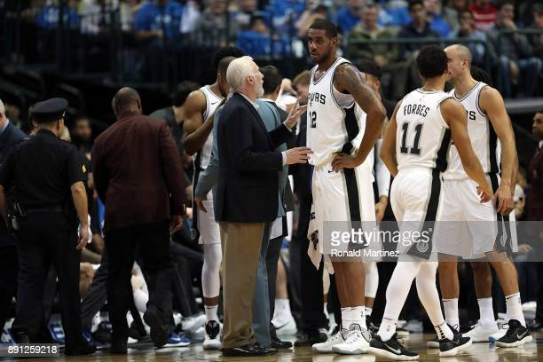 Head coach Gregg Popovich of the San Antonio Spurs talks with LaMarcus Aldridge during play against the Dallas Mavericks at American Airlines Center...