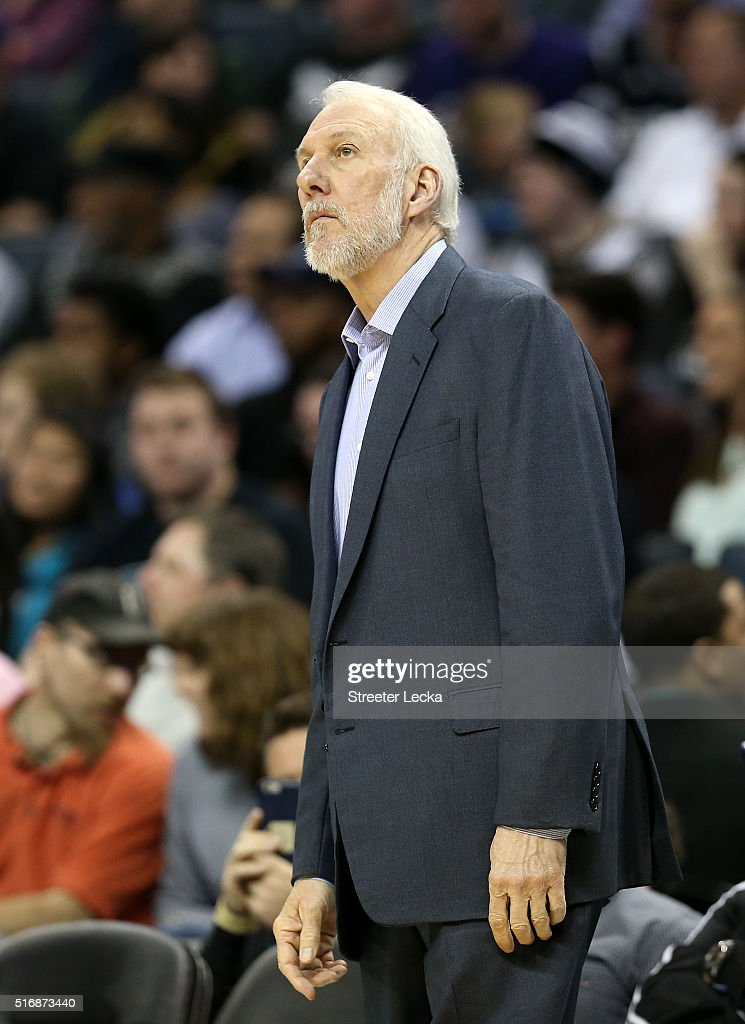 Head coach Gregg Popovich of the San Antonio Spurs watches on against the Charlotte Hornets during their game at Time Warner Cable Arena on March 21, 2016 in Charlotte, North Carolina.NOTE