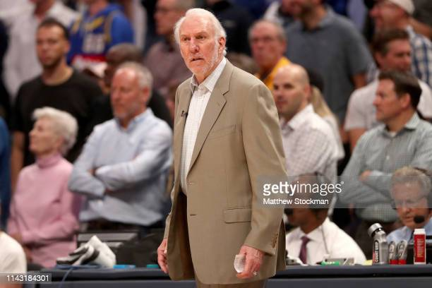 Head coach Gregg Popovich of the San Antonio Spurs works the sidelines while playing the Denver Nuggets in the fourth quarter during game two of the...