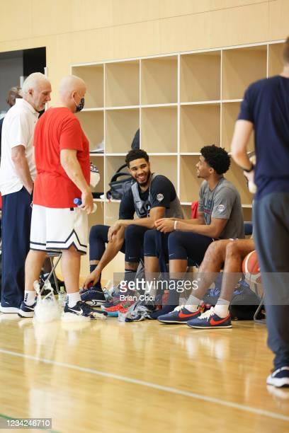 Head Coach Gregg Popovich of the USA Men's National Team talks to Jayson Tatum of the USA Men's National Team and Keldon Johnson of the USA Men's...