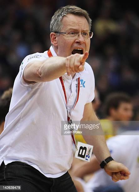 Head coach Gudmundur Gudmundsson of RheinNeckar Loewen gestures during the Toyota Bundesliga handball game between HSV Hamburg and at the O2 World on...
