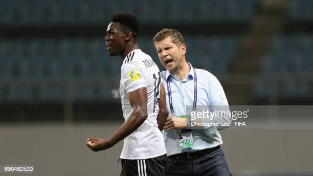Head Coach Guido Streichsbier of Germany celebrates their third goal with Jordan Torunarigha of Germany during the FIFA U20 World Cup Korea Republic...