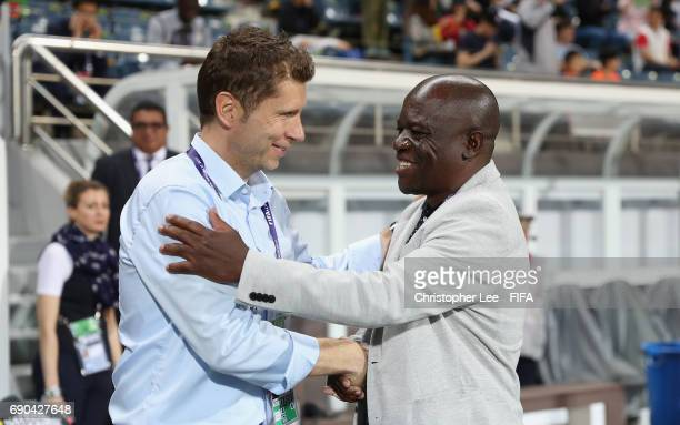 Head Coach Guido Streichsbier of Germany shakes hands with Head Coach Beston Chambeshi of Zambia before kick off during the FIFA U20 World Cup Korea...