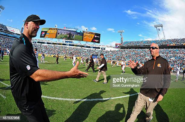 Head Coach Gus Bradley of the Jacksonville Jaguars is congratulated by Head Coach Mike Pettine of the Cleveland Browns after the game at EverBank...