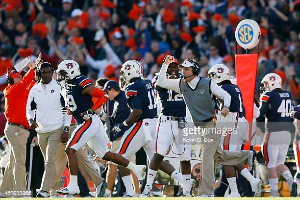 Head coach Gus Malzahn celebrates a first quarter touchdown by Nick Marshall of the Auburn Tigers against the Alabama Crimson Tide at JordanHare...