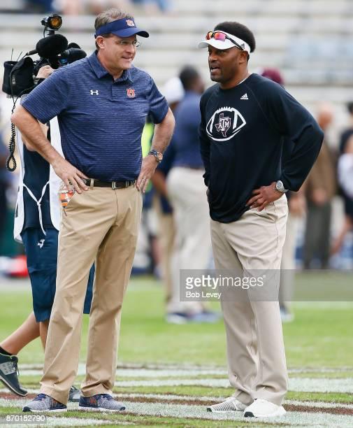 Head coach Gus Malzahn of the Auburn Tigers and head coach Kevin Sumlin of the Texas AM Aggies talk before the game at Kyle Field on November 4 2017...