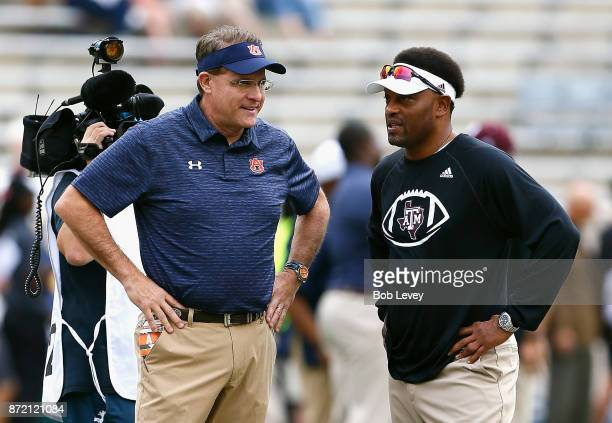 Head coach Gus Malzahn of the Auburn Tigers and head coach Kevin Summon of the Texas AM Aggies at Kyle Field on November 4 2017 in College Station...