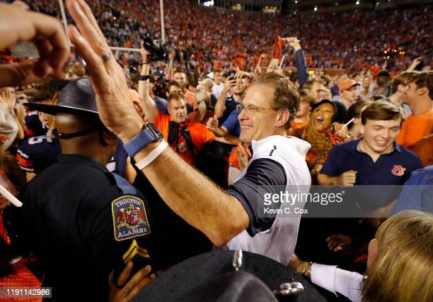 Head coach Gus Malzahn of the Auburn Tigers celebrates their 4845 win over the Alabama Crimson Tide at Jordan Hare Stadium on November 30 2019 in...