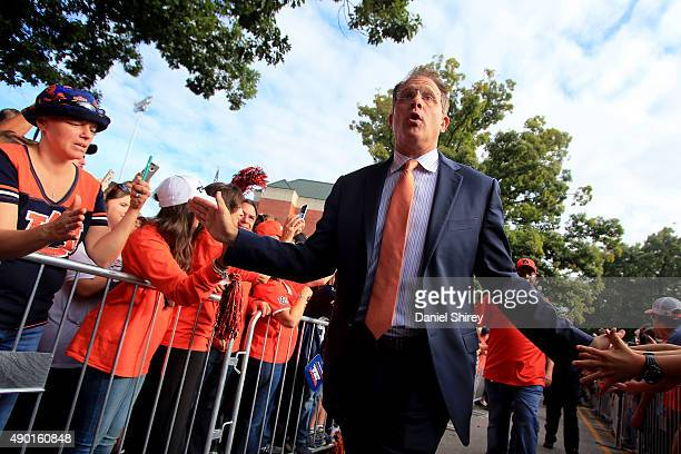 Head coach Gus Malzahn of the Auburn Tigers greets fans during the Tiger Walk prior to the game against the Mississippi State Bulldogs at Jordan Hare...
