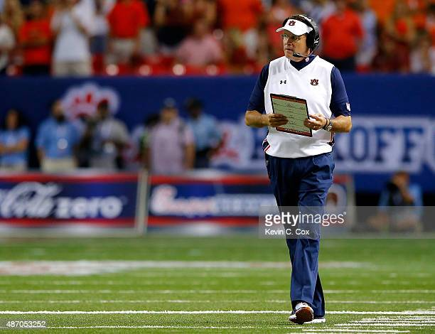Head coach Gus Malzahn of the Auburn Tigers looks on during the final minutes of their 3124 win over the Louisville Cardinals at Georgia Dome on...
