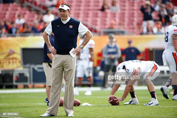 Head coach Gus Malzahn of the Auburn Tigers looks over his players as they warm up before the start of the Outback Bowl against the Wisconsin Badgers...
