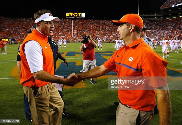 Head coach Gus Malzahn of the Auburn Tigers shakes hands with head coach Dabo Swinney of the Clemson Tigers after their game at Jordan Hare Stadium...
