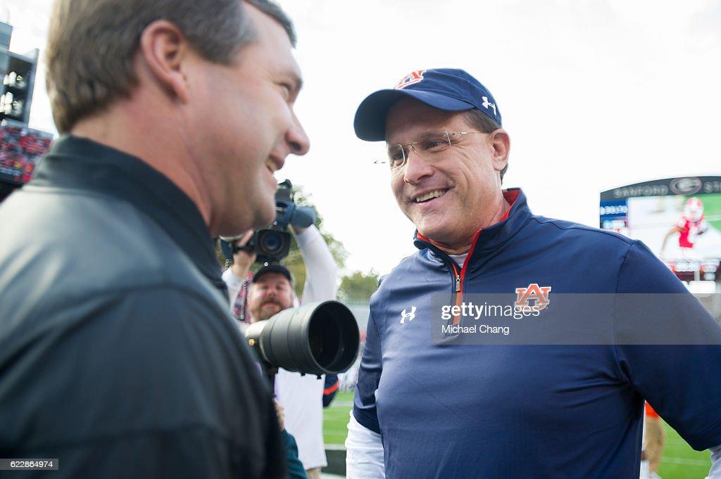 Head coach Gus Malzahn of the Auburn Tigers speaks with head coach Kirby Smart of the Georgia Bulldogs at Sanford Stadium on November 12, 2016 in Athens, Georgia.