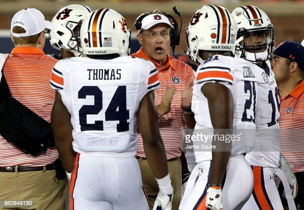 Head coach Gus Malzahn of the Auburn Tigers talks to players during the game against the Missouri Tigers at Faurot Field/Memorial Stadium on...