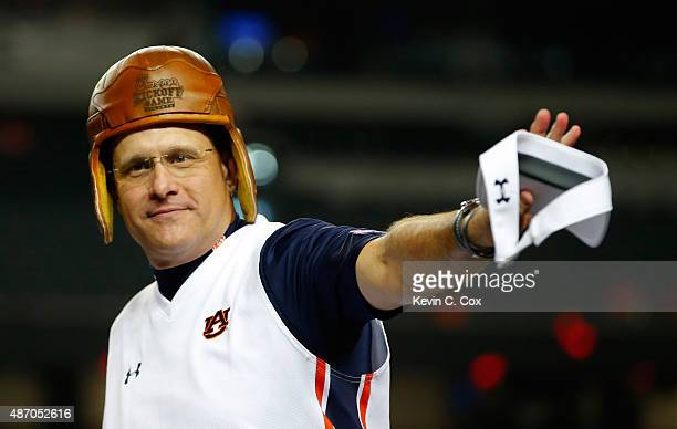 Head coach Gus Malzahn of the Auburn Tigers wears the old leather helmet trophy as he celebrates their 3124 win over the Louisville Cardinals at...