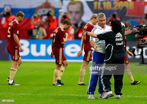 Head coach Guus Hiddink of Russia and Head coach Diego Maradona of Argentina react during the international friendly match between Russia and...