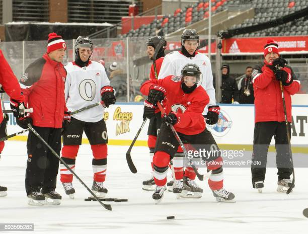Head coach Guy Boucher Gabriel Dumont and Cody Ceci of the Ottawa Senators look on as Matt Duchene of the Ottawa Senators passes the puck during...