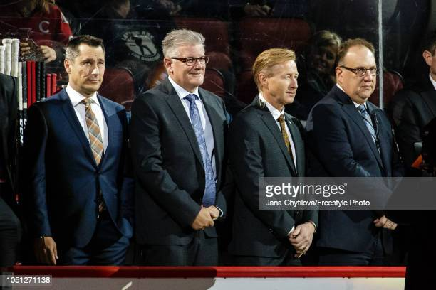 Head Coach Guy Boucher Marc Crawford Associate Coach Rob Cookson Assistant Coach and Martin Raymond Assistant Coach of the Ottawa Senators stand...
