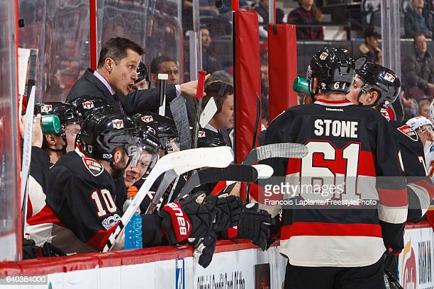 Head coach Guy Boucher of the Ottawa Senators gives instructions during a stoppage of play in an NHL game against the Calgary Flames at Canadian Tire...