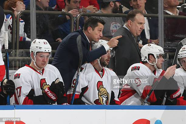 Head coach Guy Boucher of the Ottawa Senators gives instructions from the bench during the game against the New York Rangers at Madison Square Garden...