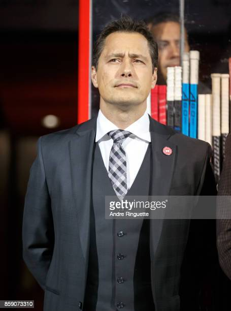Head coach Guy Boucher of the Ottawa Senators looks on during player introductions before the home opener against the Washington Capitals at Canadian...