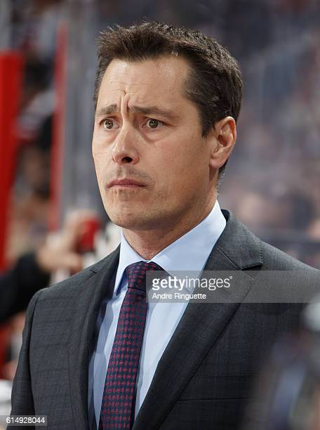 Head coach Guy Boucher of the Ottawa Senators looks on from the bench against the Toronto Maple Leafs at Canadian Tire Centre during the season...