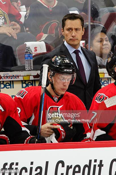 Head coach Guy Boucher of the Ottawa Senators looks on from the bench against the Toronto Maple Leafs at Canadian Tire Centre on October 12 2016 in...
