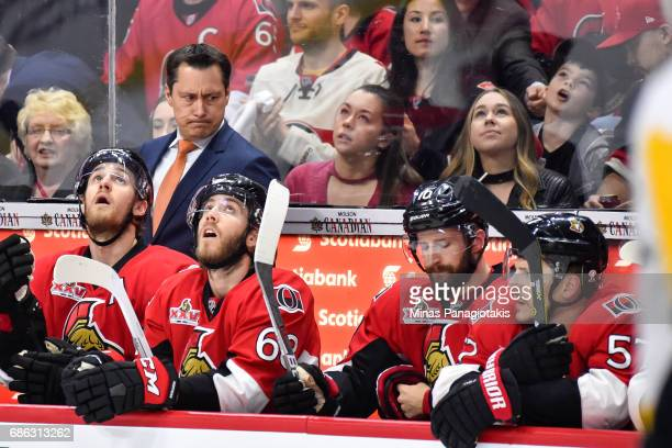 Head coach Guy Boucher of the Ottawa Senators looks towards his team against the Pittsburgh Penguins in Game Four of the Eastern Conference Final...