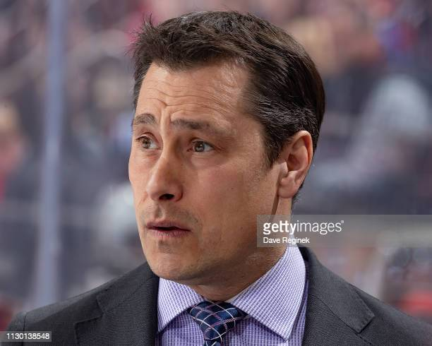 Head coach Guy Boucher of the Ottawa Senators watches the action from the bench against the Detroit Red Wings during an NHL game at Little Caesars...