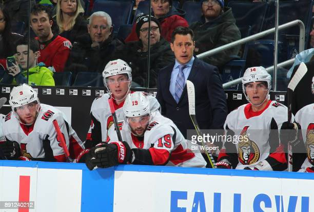 Head coach Guy Boucher of the Ottawa Senators watches the game action against the Buffalo Sabres during an NHL game on December 12 2017 at KeyBank...