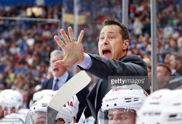 Head coach Guy Boucher of the Ottawa Senators yells from bench during their NHL game against the Vancouver Canucks at Rogers Arena October 10 2017 in...