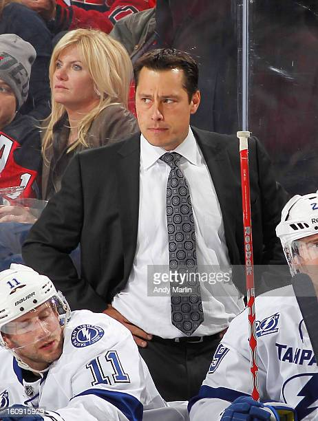 Head coach Guy Boucher of the Tampa Bay Lightning looks on angrily after a penalty call against his team against the New Jersey Devils during the...