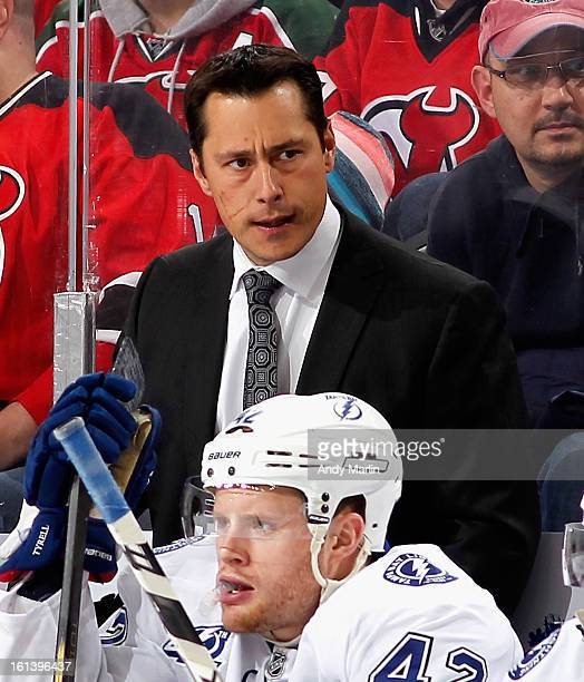 Head coach Guy Boucher of the Tampa Bay Lightning looks on during the game against the New Jersey Devils at the Prudential Center on February 7 2013...