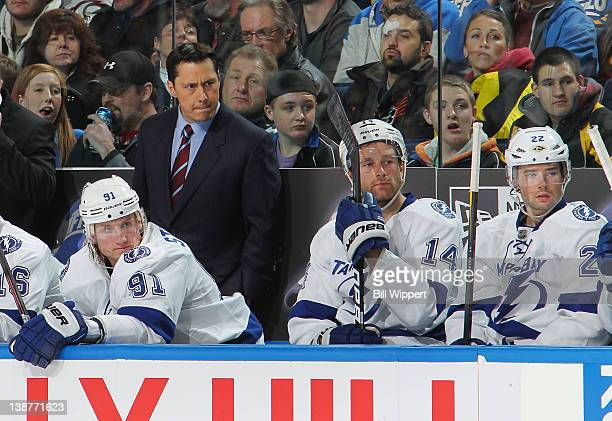 Head coach Guy Boucher of the Tampa Bay Lightning watches the third period of their 21 victory over the Buffalo Sabres at First Niagara Center on...