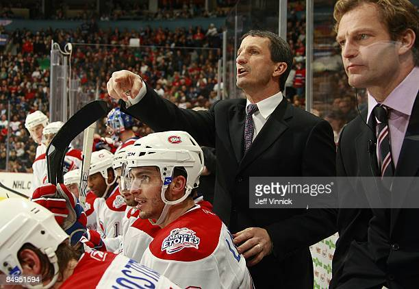 Head coach Guy Carbonneau of the Montreal Canadiens looks on from the bench during their game against the Vancouver Canucks at General Motors Place...