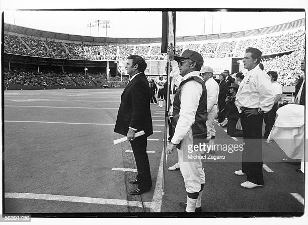 Head coach Hank Stram and assistant coach Dick Nolan of the New Orleans Saints watch from the sideline against the San Francisco 49ers at Candlestick...