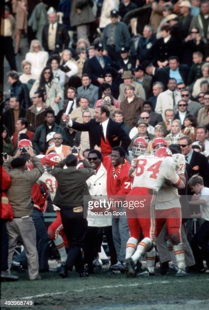 Head Coach Hank Stram of the Kansas City Chiefs gets carried off the field by his players after they defeated the Minnesota Vikings in Super Bowl IV...