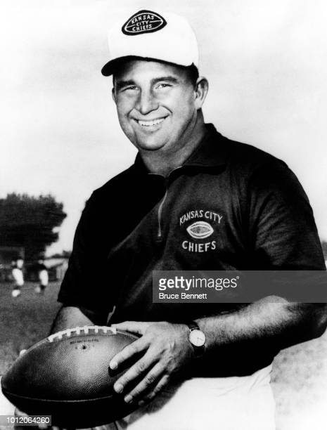 Head coach Hank Stram of the Kansas City Chiefs poses with a football circa 1970