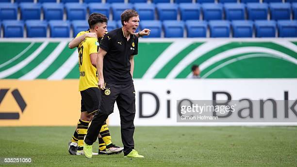 Head coach Hannes Wolf of Dortmund celebrates his team's fifth goal during the A Juniors German Championship Final match between 1899 Hoffenheim U19...