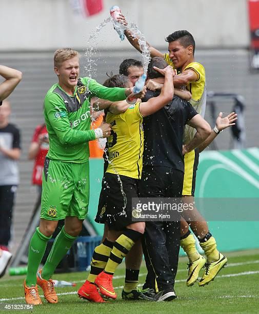 Head coach Hannes Wolf of Dortmund gets a water shower after winning the B Juniors Bundesliga final match between RB Leipzig and Borussia Dortmund at...