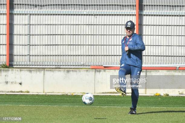 Head coach HansDieter Flick of Bayern Muenchen passes the ball during a training session at Saebener Strasse training ground on April 06 2020 in...