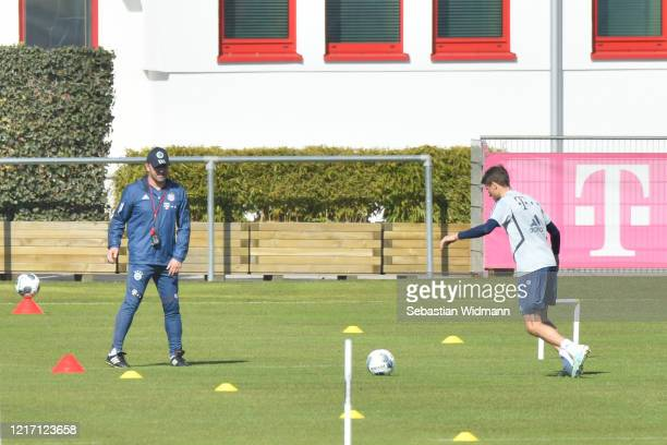 Head coach HansDieter Flick of Bayern Muenchen watches Thomas Mueller during a training session at Saebener Strasse training ground on April 06 2020...