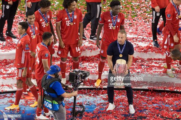 head coach HansDieter Flick of Bayern Muenchen with the cup celebrate after winning the UEFA Super Cup match between FC Bayern Munich and FC Sevilla...
