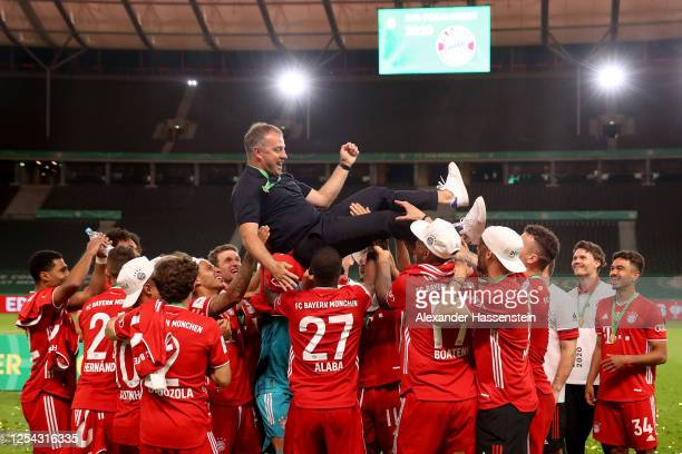 Head coach Hans-Dieter Flick of FC Bayern Muenchen celebrates with his players after the DFB Cup final match between Bayer 04 Leverkusen and FC...