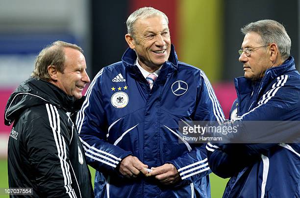 Head coach HansHubert Vogts of the World Champion 1990 head coach Eduard Geyer and coach Eberhard Vogel of the DFV Legend talk prior to the...